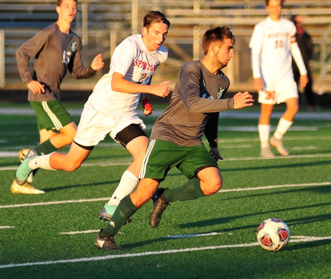 Madison's Gavon Huggins kicks the ball down the field while playing against Lima on Thursday evening.