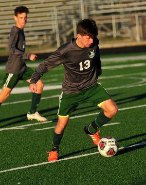 Madison's Owen Ross kicks the ball down the field while playing against Lima on Thursday evening.