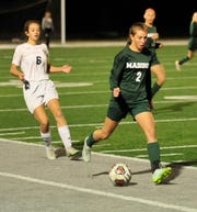 Madison's Kalie Blaising kicks the ball down the field while playing against Tiffin Columbian on Thursday evening.