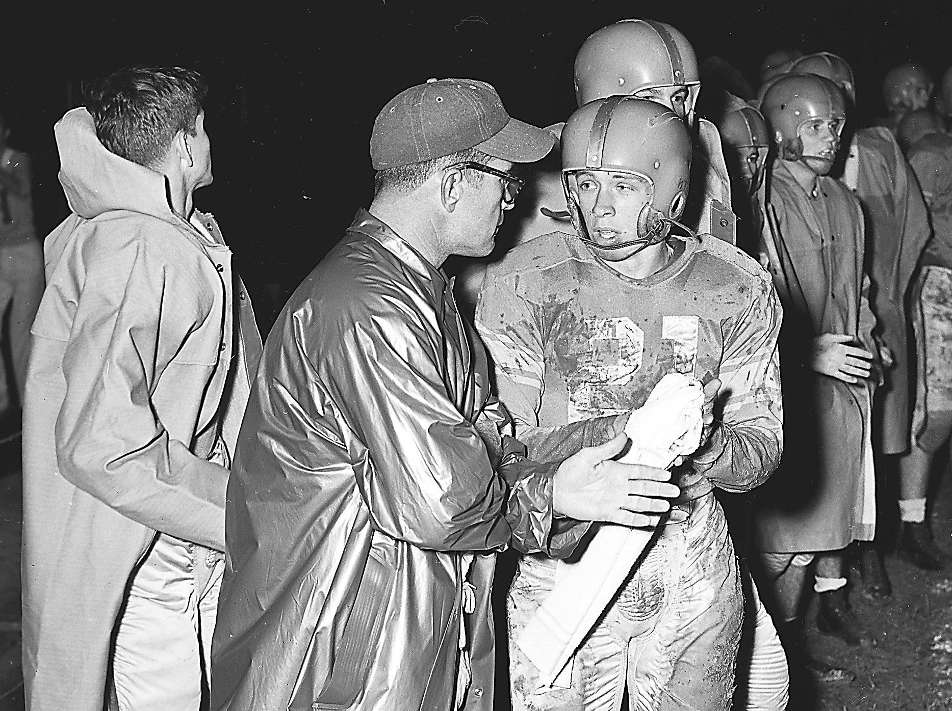 A TD talk is held between Humes coach Rube Boyce and halfback George Blancett.  Blancett had just scored Humes' first touchdown on a 33 yard run.  Humes went on to whip East High 50 - 0 at Hodges Field on 23 Oct 1951.