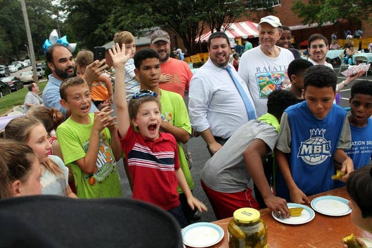Kids participate in the pickle-eating contest at the ASBEE World Kosher BBQ Competition & Festival. This year's event will be on Sunday.