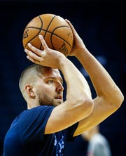 Grizzlies forward Chandler Parsons warms up before taking on the Hawks in their home opener Oct. 19.