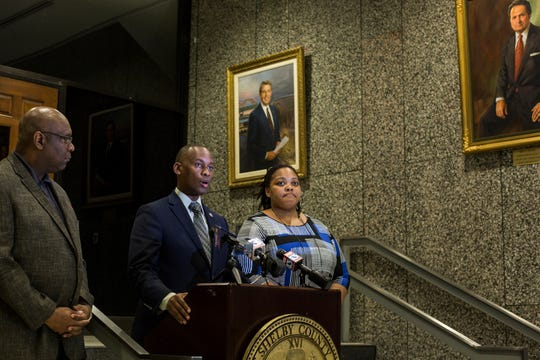 Shelby County Commission Chairperson Van Turner, along with Commissioner Reginald Milton, left, and Commissioner Tami Sawyer, right, speak during a press conference Friday.