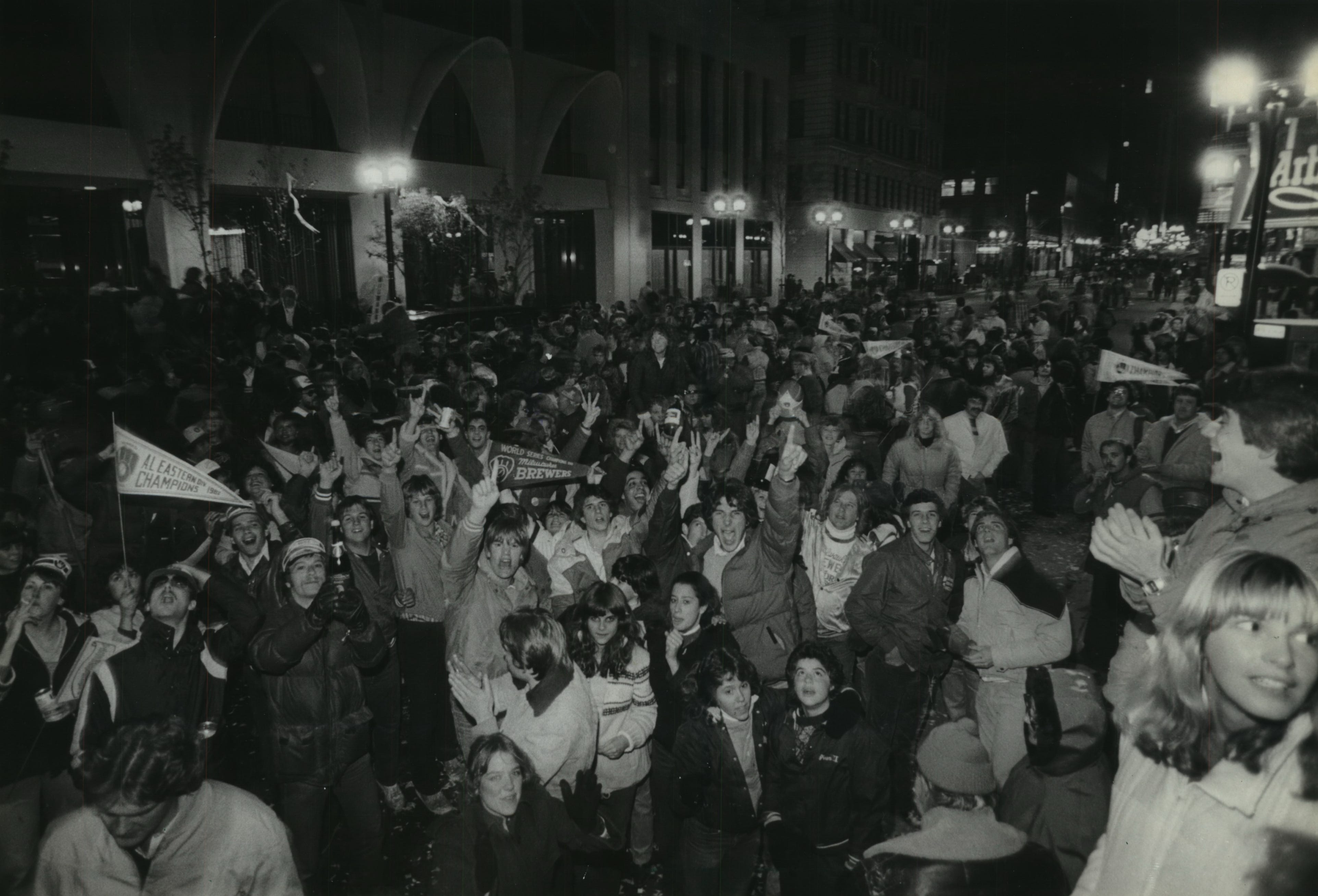 """Fans pour out onto W. Wisconsin Avenue on Oct. 20, 1982, to """"celebrate"""" the Brewers' loss to the St. Louis Cardinals in Game 7 in the 1982 World Series. This photo was published in the Oct. 21, 1982, Milwaukee Journal."""