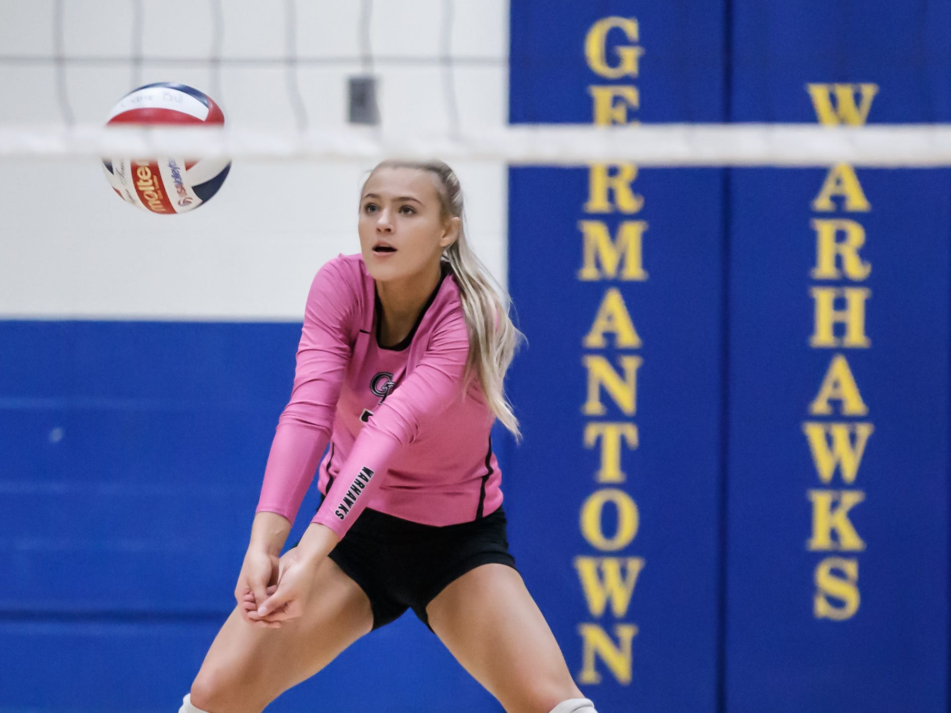 Germantown junior Amber Bischel bumps a serve during the WIAA Regional match at home against Homestead on Thursday, Oct. 18, 2018.