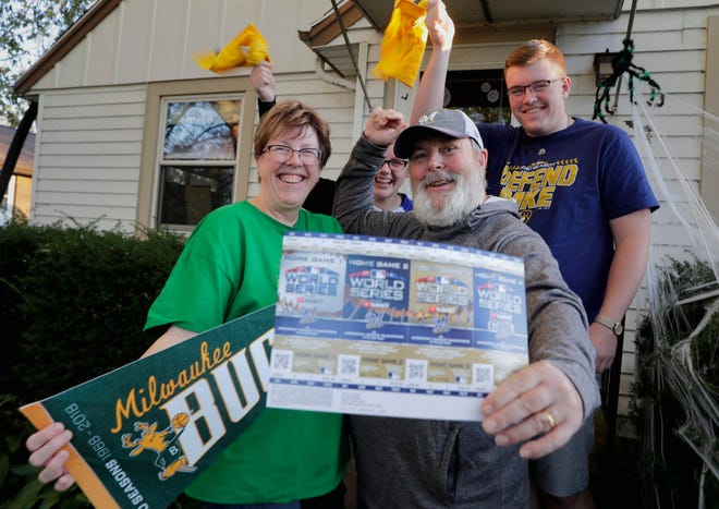 John Millane and his wife, Carolyn, have season tickets for the Milwaukee Bucks and the Brewers, including playoff tickets. They and their children, Caitlin and Jack, celebrate the success but the couple is torn about which game to go to Friday night -- the Bucks home opener or the Brewers playoff game at Miller Park.