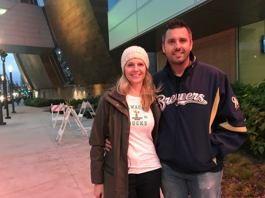 Dustin and Jill Sontag of Germantown sold their Brewers tickets for Friday night and attended the Milwaukee Bucks home opener at Fiserv Forum