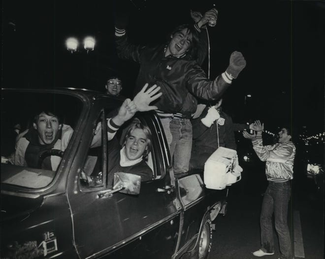 Believe it or not, these Brewers fans are celebrating after Milwaukee lost Game 7 of the 1982 World Series to the St. Louis Cardinals on Wisconsin Ave. on Oct. 20, 1982.