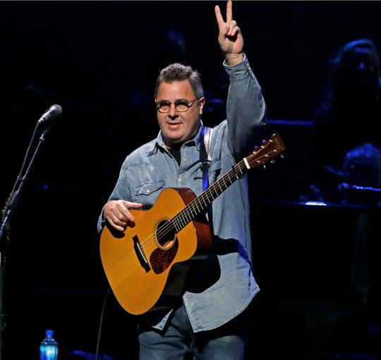 Vince Gill acknowledges the crowd. RIck Wood,