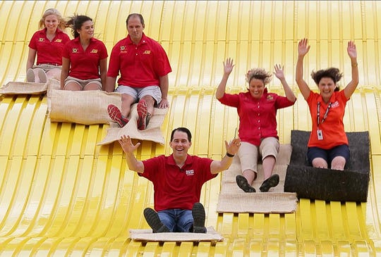 Governor Scott Walker slides down the Giant Slide at the Wisconsin State Fair in August, marking the opening of the 167th fair and the 50th anniversary of the State Fair's Giant Slide at Wisconsin State Fair Park.