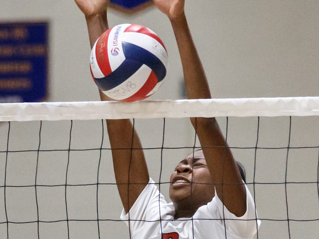 Homestead senior Makalya Wright (12) blocks a shot at the net during the WIAA Regional match at Germantown on Thursday, Oct. 18, 2018.