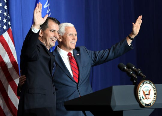 Vice President Mike Pence (right) campaigns in October for Wisconsin Gov. Scott Walker at Precision Pipeline, northwest of Eau Claire. (Photo: Dan Reiland, Associated Press)