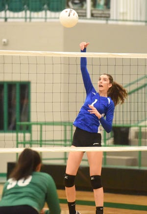 Cotter's Christianne Crunkleton hits during a district tournament match.