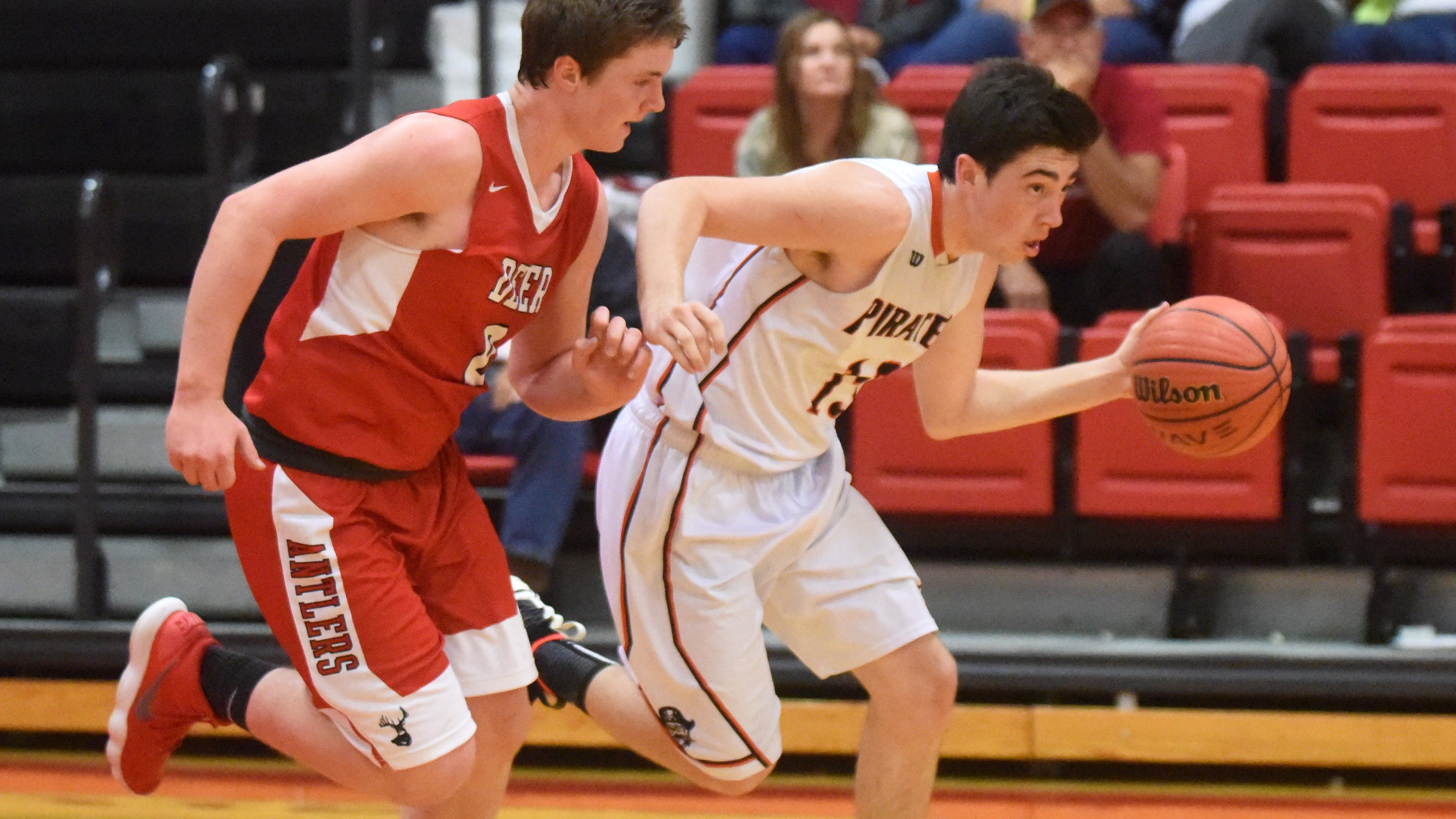 Calico Rock's Connor Sanders dribbles upcourt while guarded by Deer's Avery Young on Thursday night at Norfork.