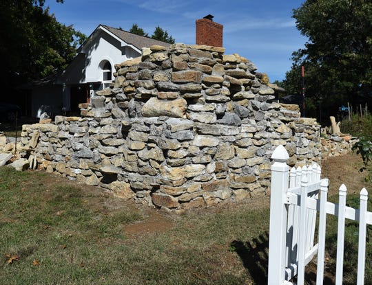 A large rock wall partially obscures an unfinished garden pond at 1710 Lilac. The Mountain Home City Council on Thursday night agreed to seek a court order ordering that the water feature be removed.