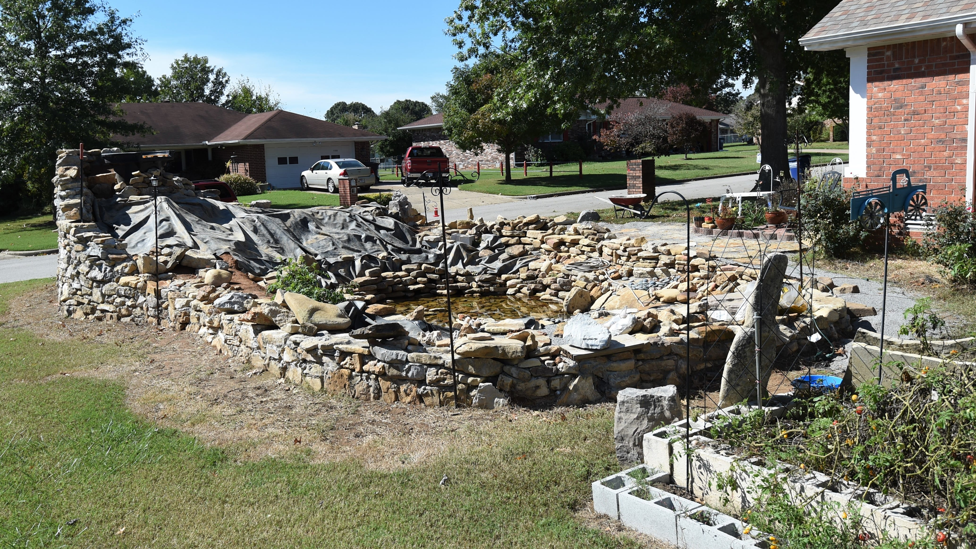 This large, unfinished garden pond must be torn down, the Mountain Home City Council agreed Thursday night.