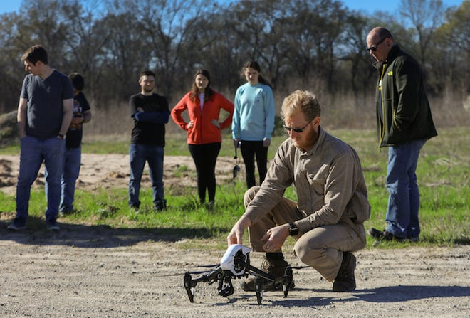 Sean Chenoweth demonstrates using a drone, also known as an Unmanned Aerial System, to students at the University of Louisiana Monroe. Chenoweth will lead a program to teach people how to use UAS thanks to a $90,000 grant by Delta Regional Authority.