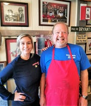 Alabama fan Jeff Davis is the owner of Shuford's Smoke House in Tennessee. His daughter Madison is a Tennessee fan