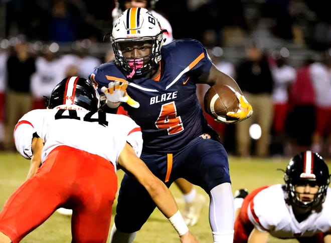 Blackman's Jordan Brown (4) runs the ball as Stewarts Creek's Zachery Snider (44) moves in for a tackle, on Thursday, Oct. 18, 2018.