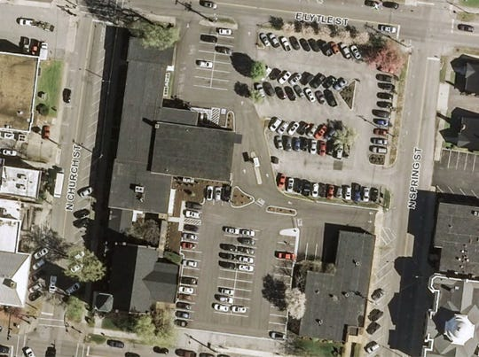 This aerial view shows the historic former First United Methodist Church property in downtown Murfreesboro. The City Council has reached an agreement to sell the property and an adjacent parking lot for $1.8 million for redevelopment that may include a Starbucks, a 110-room hotel, 55 condos, a parking garage, offices and stores. The city bought the church property January 2016 from Franklin Synergy Bank for $1.55 million.