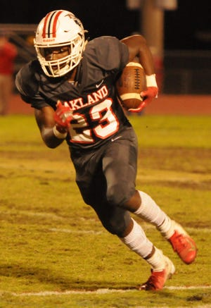 Oakland's  B.J. Connard looks for running room during a recent game. Connard was voted area boys athlete of the week for Oct. 29-Nov. 3.