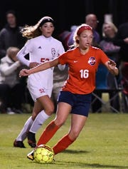 Oakland's Faith Adams (16) dribbles in front of Stewarts Creek's Dakota Mitchell during a 2018 match.