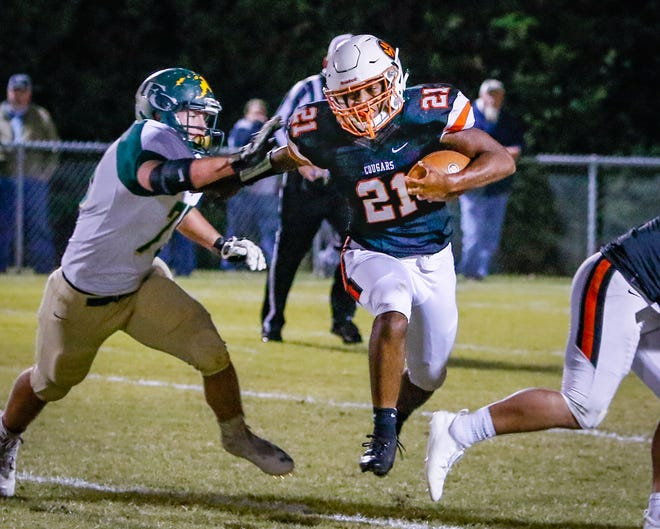 MTCS' Kemari McGowan finds a hole in the Friendship Christian defense.