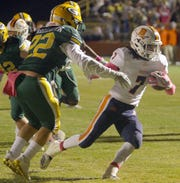 Beech's Ja'Sean Parks rushes past Gallatin's Trustyn Kemp on his way to the end zone on Thursday, October 18, 2018.