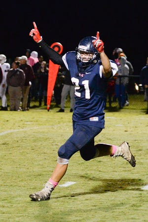 White House Heritage player Trenton Tuttle celebrates a win against East Robertson High School at White House Heritage on Thursday, Oct. 18.