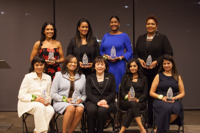 At the 2018 Women of Color Awards given by the 100 Black Men of Middle Tennessee and the Women Presidents' Organization are, back row, from left, honoree Page Turner, Page Turner Unlimited; honoree LaDonna Boyd, RH Boyd Publishing Corp.; Candace Rivers, who accepted the award on behalf of honoree Danielle Austen, Fluent 360; honoree Brenda Odom, U-Kno Catering; front row, honoree Sharon Reynolds, Devmar Products; honoree Pam Martin, Cushion Employer Services; Dr. Marsha Firestone, Women Presidents' organization and founder; honoree Nisha Goyal-Parikh, Gabbyville Virtual Receptionist; and honoree Darpan Mukerji, UNIIK. (Photo: 100 Black Men of Middle Tennessee/Women Presidents' Organization)
