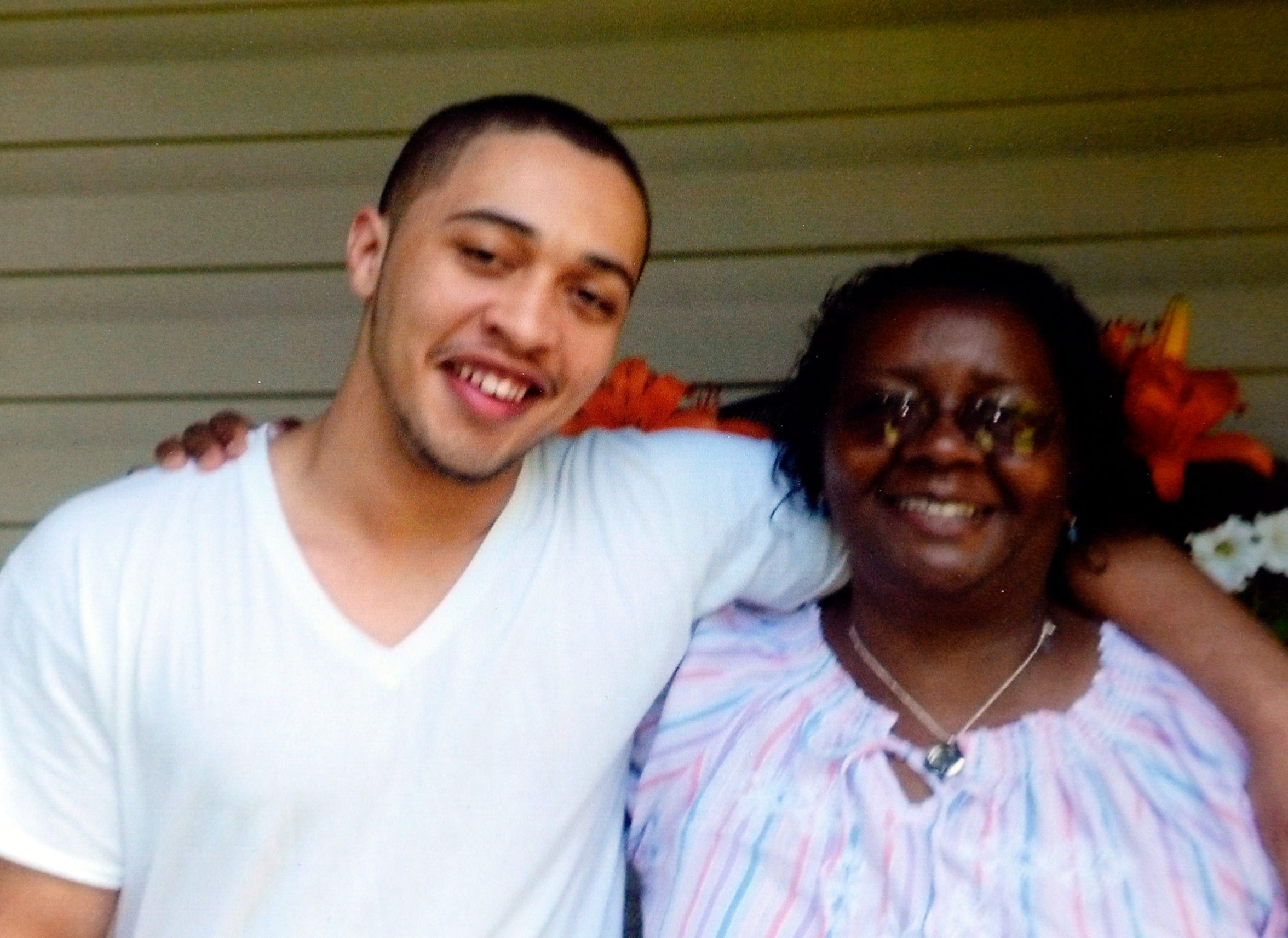 Josh Holton smiles with his grandmother, Mary Holton, in an undated family photo. Josh Holton, 20, died of a drug overdose in 2016.