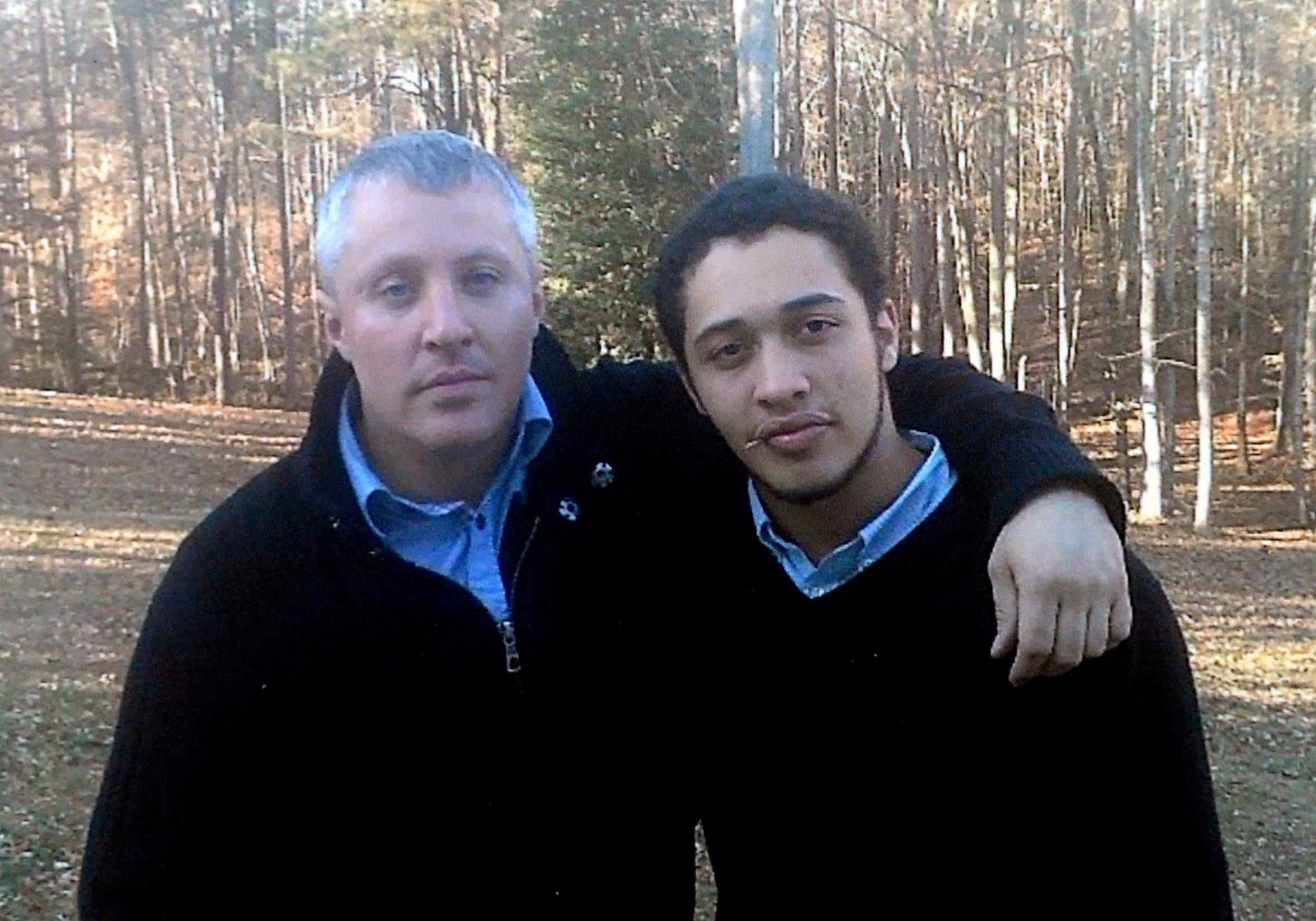 Josh Holton, right, poses with his biological father, Doug Brown, in an undated family photo. Brown drowned in 2015, then Holton died of a drug overdose the next year.