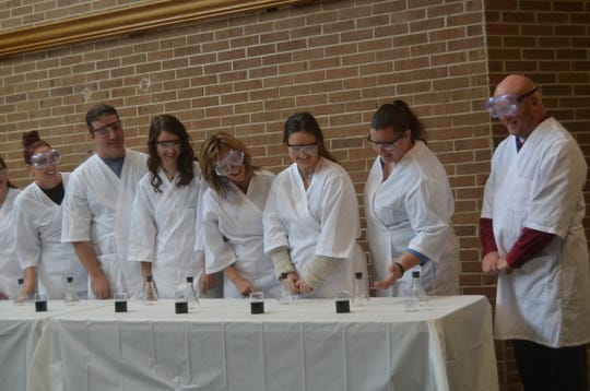 Students show a chemistry demonstration at the groundbreaking of an extensive renovation of the Warf Math and Science Building at Volunteer State Community College.