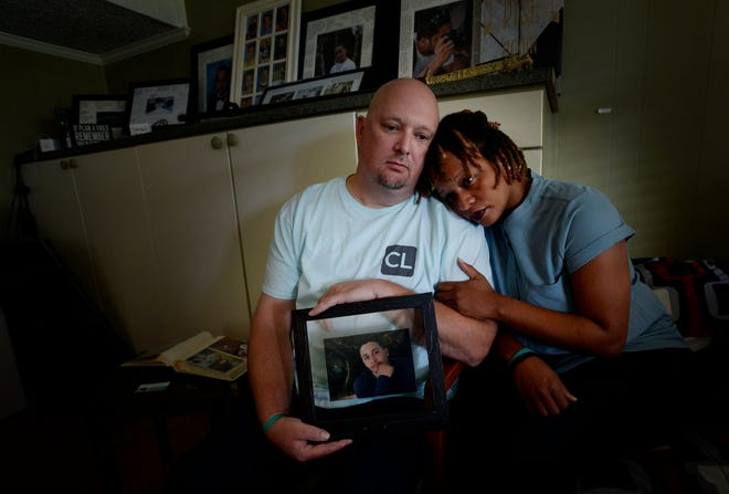 Michael and Rachel Blado hold a photograph of their son Josh Holton as they sit in his bedroom Oct. 18, 2018, in Antioch. Holton died of a drug overdose in 2016 after buying what he thought was Xanax online but receiving fentanyl instead.