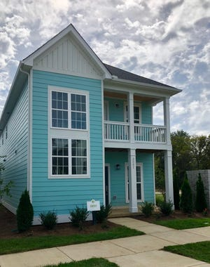 Parkside Builder's new model home in Waterford Village has 1,794 square feet, three bedrooms and two-and-a-half baths. The pastel exterior and second-level porch are popular features.