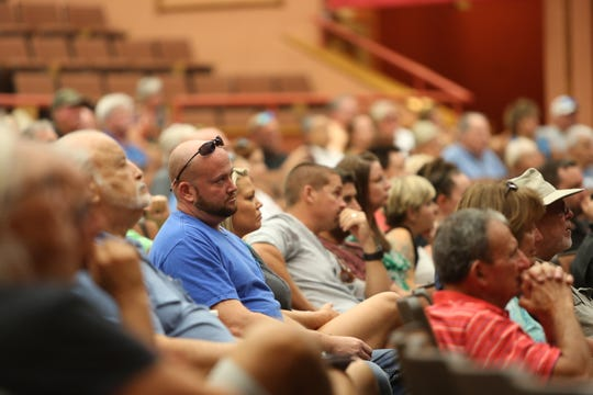 More than 100 residents filled the Estero High School auditorium to hear developer London Bay Homes' plans of a continuing care retirement community for the former Weeks Fish Camp.