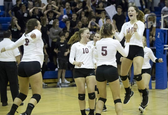First Baptist Academy volleyball players celebrate beating The Canterbury School in the District 3A-6 final on Thursday, Oct. 18, 2018 at Canterbury in Fort Myers.