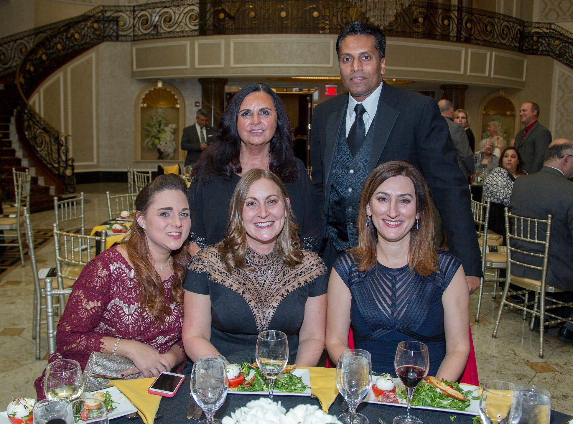 Kendall Lilienthal, Tara Trace, Yuliya Loboda, Jane Detorre, Trevor Prashad. Christian Health Care Center held its ' A Celebration of Excellence' gala at the Venetian in Garfield.  10/17/2018