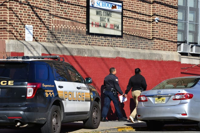 A heavy police presence at Public School 10 on Mercer St in Paterson on Friday morning October 19, 2018.