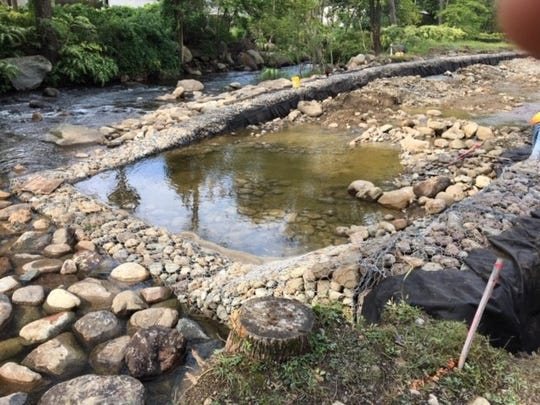 A flood mitigation project at Sloan Park in Bloomingdale is attempting to rebuild the riverbanks with caged stone.