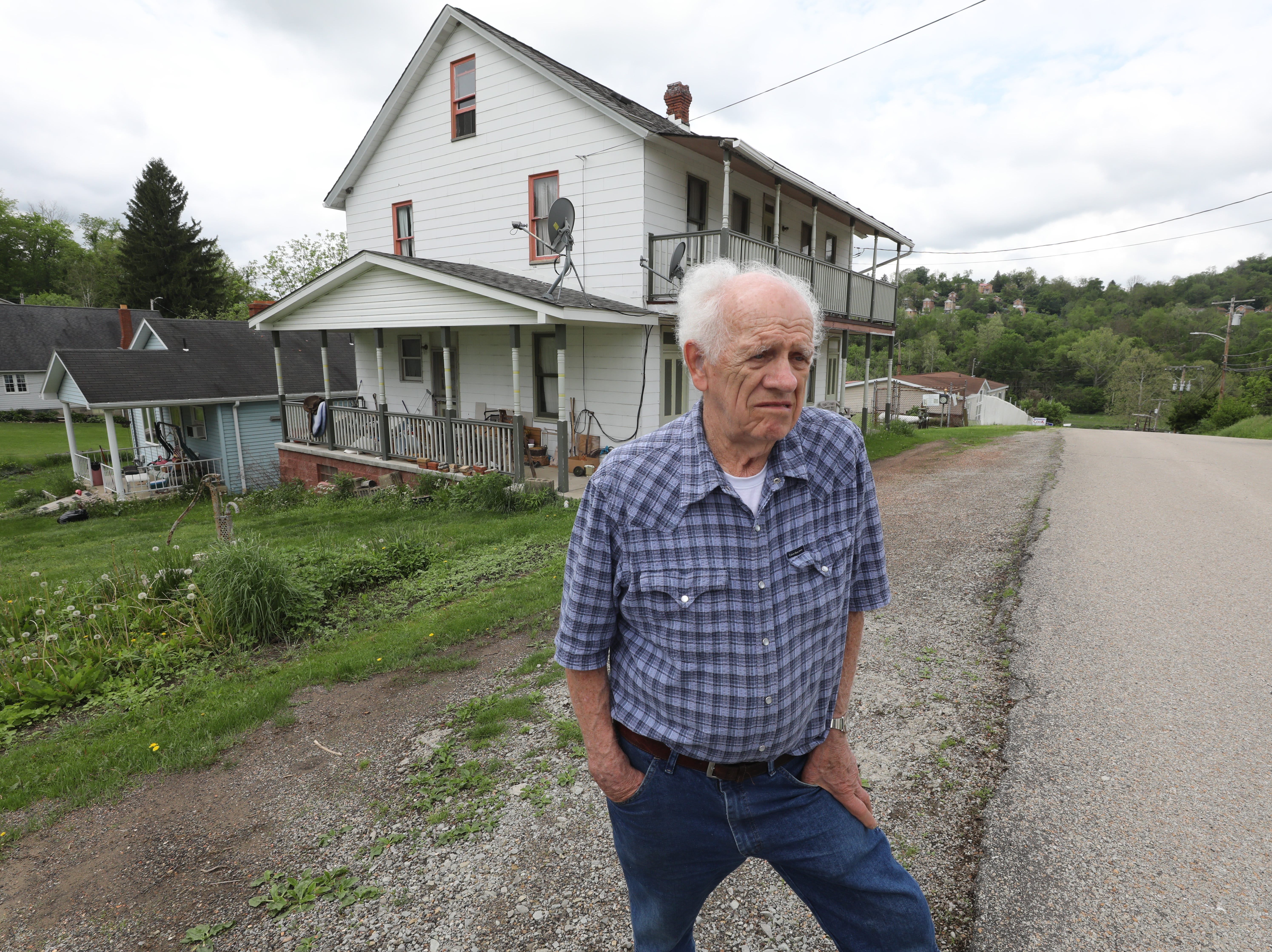 Former coal miner Rich Anseol outside a house that used to be a boarding house for coal miners.