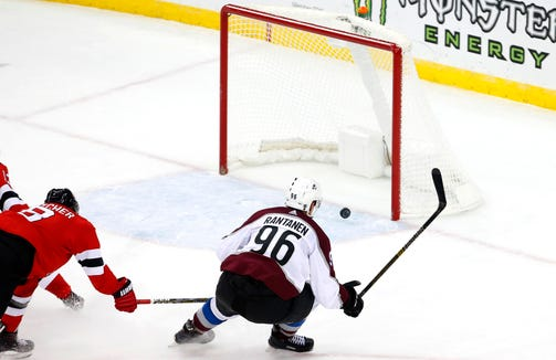 Oct 18, 2018; Newark, NJ, USA; Colorado Avalanche right wing Mikko Rantanen (96) scores an empty net goal against New Jersey Devils defenseman Will Butcher (8) during the third period at Prudential Center.