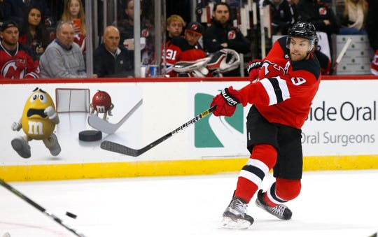 Oct 18, 2018; Newark, NJ, USA;New Jersey Devils left wing Taylor Hall (9) shoots the puck against the Colorado Avalanche during the second period at Prudential Center.