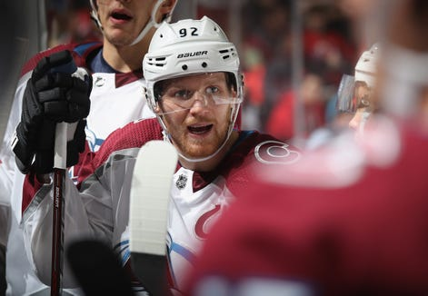 NEWARK, NEW JERSEY - OCTOBER 18: Gabriel Landeskog #92 of the Colorado Avalanche speaks with coaches during the second period against the New Jersey Devils the Prudential Center on October 18, 2018 in Newark, New Jersey.