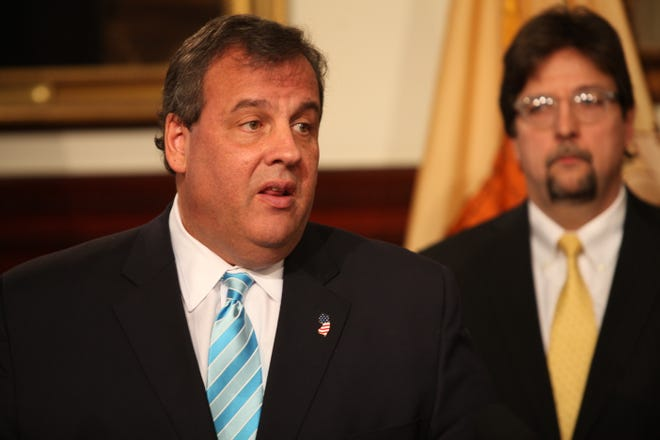 Dec. 19, 2013: Governor Chris Christie during a press conference where he introduced cabinet members that were leaving and those that are replacing them.Behind him is Charles McKenna outgoing Chief Counsel.