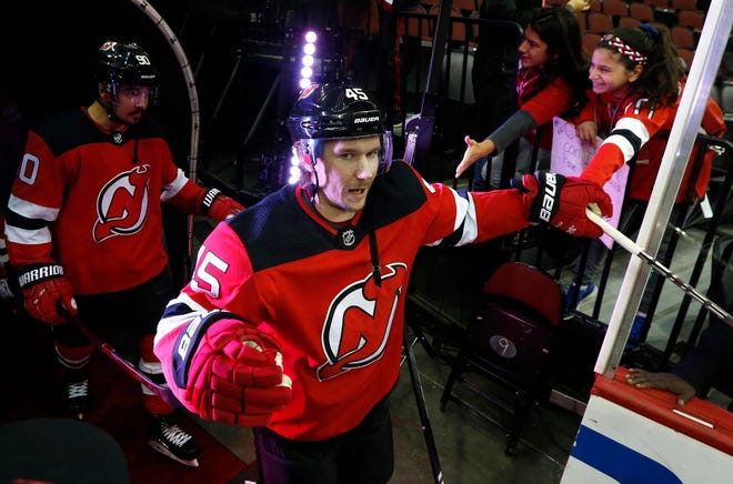 Oct 18, 2018; Newark, NJ, USA; New Jersey Devils defenseman Sami Vatanen (45) shakes hands with fans before game against Colorado Avalanche at Prudential Center.