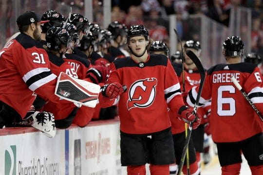New Jersey Devils center Nico Hischier, center, of Switzerland, celebrates his goal against the Colorado Avalanche with teammates during the first period of an NHL hockey game, Thursday, Oct. 18, 2018, in Newark, N.J.