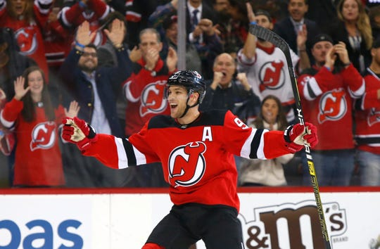 Oct 18, 2018; Newark, NJ, USA; New Jersey Devils left wing Taylor Hall (9) celebrates after scoring a goal against the Colorado Avalanche during the second period at Prudential Center.