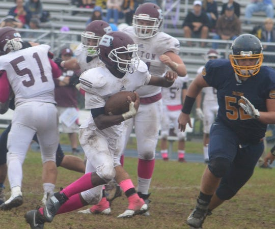 Cencir Bacote looking for running room in a game against Saddle Brook.