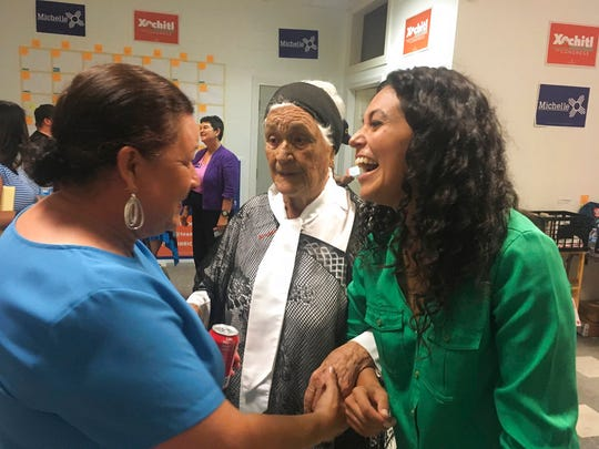 In this Oct. 3, 2018 photo, Democratic Congressional hopeful Xochitl Torres Small, right, greets supporters at the opening of her Sunland Park, New Mexico office.